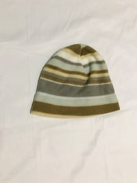 white and brown stripe cap New York, 10463