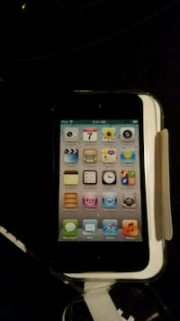 8GB-Silver Ipod touch with head phones  50 km