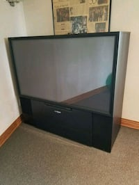 black wooden TV stand with gray CRT television Littleton, 80126