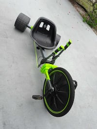 toddler's black and green pedal trike