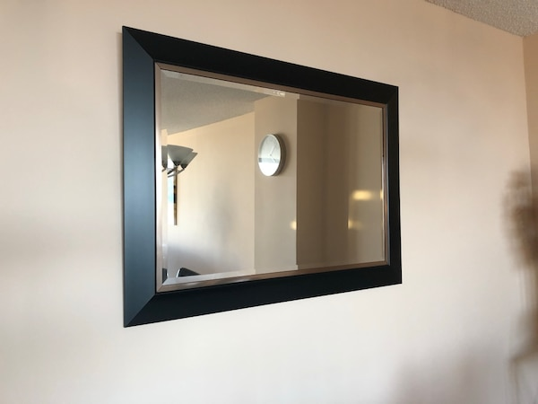 Gorgeous black framed wall mirror.