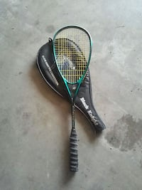 black and green tennis racket