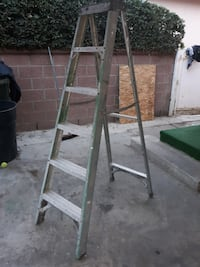 green and gray Werner a-frame ladder Downey