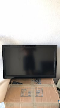 black flat screen TV with remote Ponte Vedra Beach, 32082