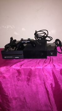 black Sony PS4 console with controller