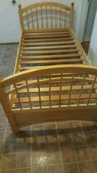 brown wooden bed frame with mattress Montréal, H1P 2P7