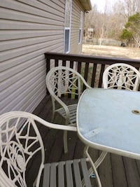Glass top patio table, 4 chairs, cushions
