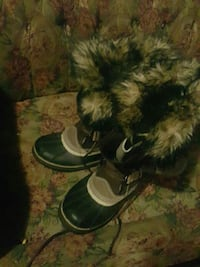pair of gray Sorel Caribou duck boots