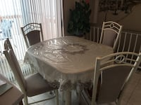 Kitchen table and four chairs  Laval, H7S 2N5