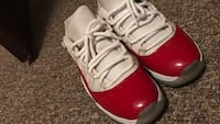 pair of white-and-red Air Jordan 11 Fayetteville, 28314