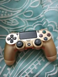 black and brown Sony PS4 controller Tampa