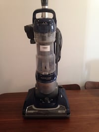 black and gray upright vacuum cleaner Laval, H7W