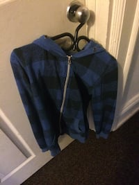 blue and black checked zip-up hoodie