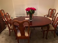 Oval brown wooden table with extension and six chairs dining set Leesburg, 20175