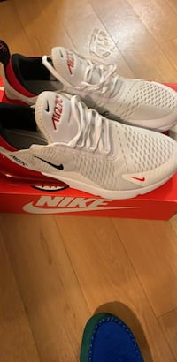 white-and-red Nike running shoes on box Laurel, 20708