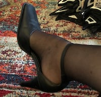 Pair of black leather heeled shoes