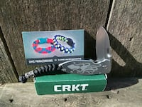 Silver CRKT folding knife with lanyard and box