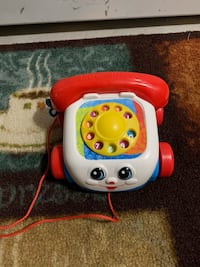 Fisher price toy phone with pull string.