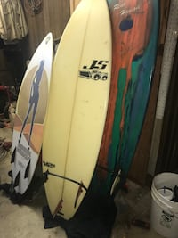 Three assorted colored wooden surf board