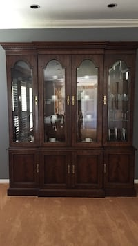 2 piece brown wooden china cabinet Houston, 77096
