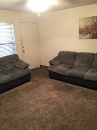 Moving and must sell — Custom, one of a kind, leather rimmed sofa and love seat. Please see attached pictures. The set originally cost me almost $2,800. Henderson, 89014