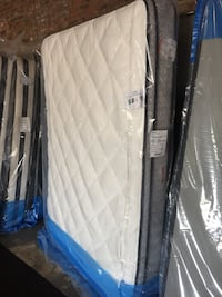 White and blue quilted mattress