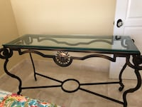 Sofa table. Wrought iron solid heavy frame and thick glass top. Perfect condition . Weston, 33331
