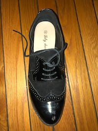 Black-and-white leather wingtip dress shoes