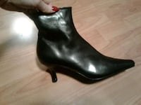 pair of black leather heeled boots North Vancouver, V7L 3C9