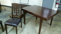 brown wooden table with four chairs dining set Upper Marlboro