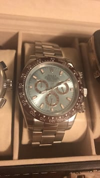 round silver-colored chronograph watch with link bracelet Mississauga, L5M 5V3