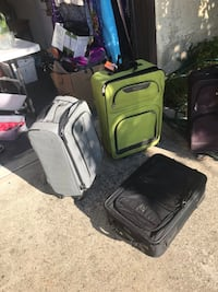 Two black and one gray luggage bags 2384 mi