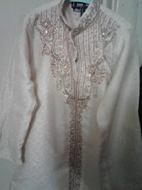 white and gray floral long-sleeved traditional dress