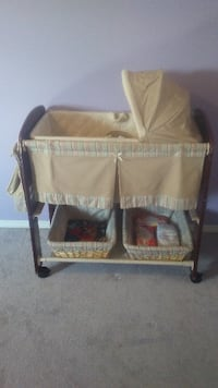 Bassinet, beige in color. 2 baskets at bottom and pouch on side. As is for $40 OBO. Calgary