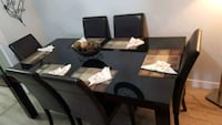 Black glass dinning with six leather chairs  Toronto, M3A 2T9
