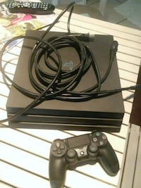 black Sony PS4 pro console with controller Ocala, 34480