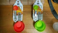 two sets of red and green measuring cups Burlington, L7N