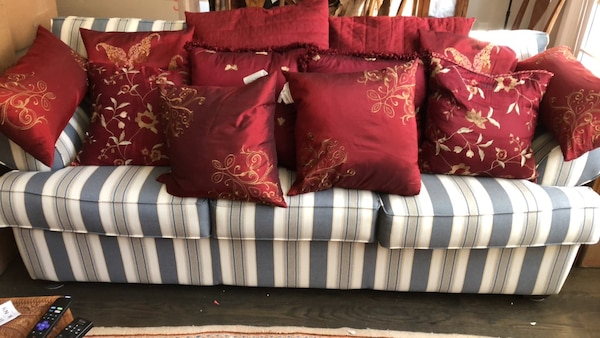 12 red and gold pillows