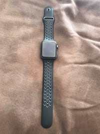 black cased Apple watch with black sports band Nike series 2