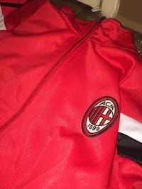 red and black Adidas zip-up jacket