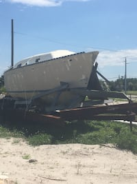 Extra heavy duty trailer for sale with 1978 hunter sailboat mast and newer Yamaha 25 hp outboard. Needs complete rebuilding but great investment for live aboard  By the trailer and get a free boat  Grant-Valkaria, 32949
