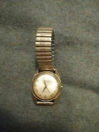 round gold analog watch with link bracelet Red Deer, T4N 4L5