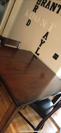 rectangular brown wooden table with four chairs dining set 65 km