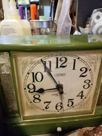 white and green analog wall clock Montreal