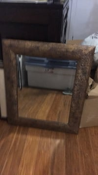 brown wooden framed wall mirror 801 km