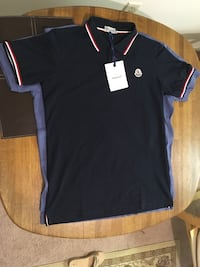 Moncler golf shirt.  New with tags   Navy.  Size Large Slim Fit  206 mi