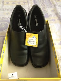 Pair of black leather shoes in box new excellent condition . Winnipeg, R2K 2C6