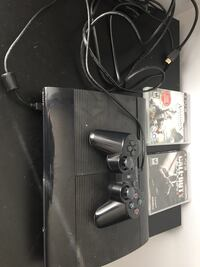 Black sony ps3 super slim console with controllers Fort Saskatchewan, T8L 3G5