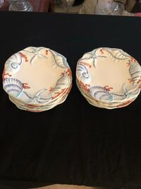 two white-and-red ceramic plates 1201 mi