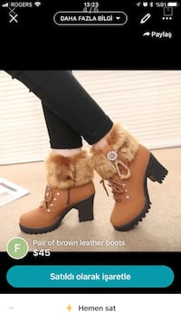 pair of brown leather boots screenshot